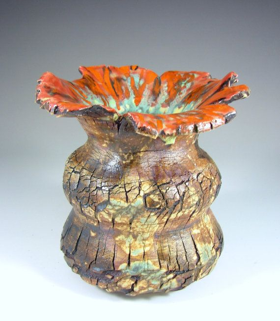 This ceramic stoneware sculpture, has the most gorgeous glazes. It is cracked and stained with rust, green and copper stains on the outside and the
