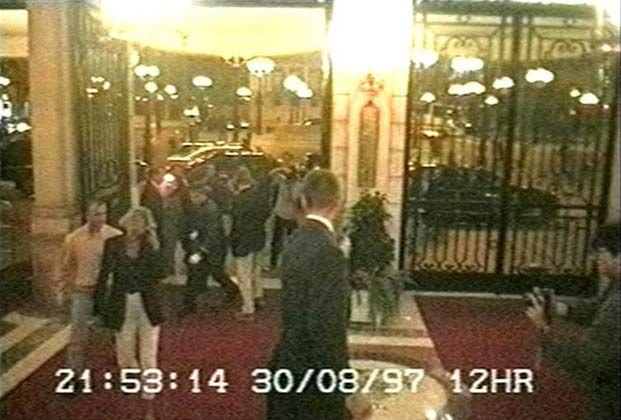 This image made from CCTV footage shows Diana (second from left), with bodyguard Kes Wingfield (left) arriving back at the Ritz Hotel in Paris for the final time. .