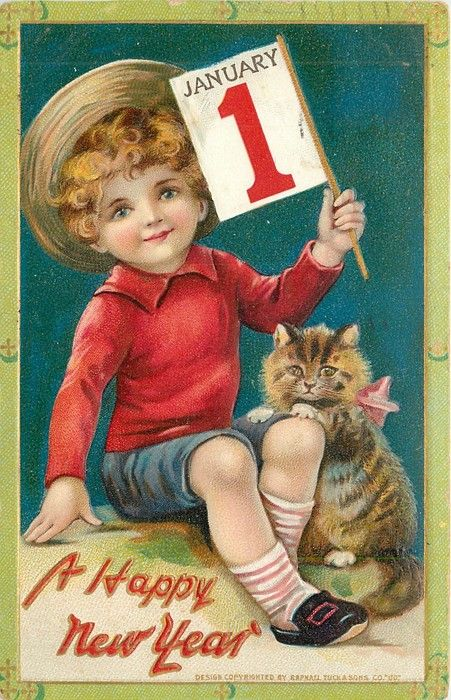 boy in red jumper sits next to kitten & holds JANUARY 1 ...