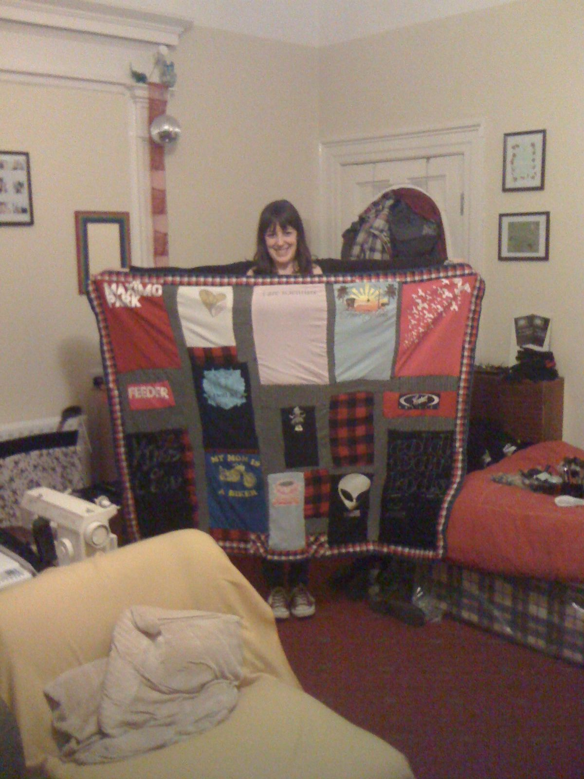 I needed something to do with a bunch of band t-shirts so I made a band quilt, I love it!