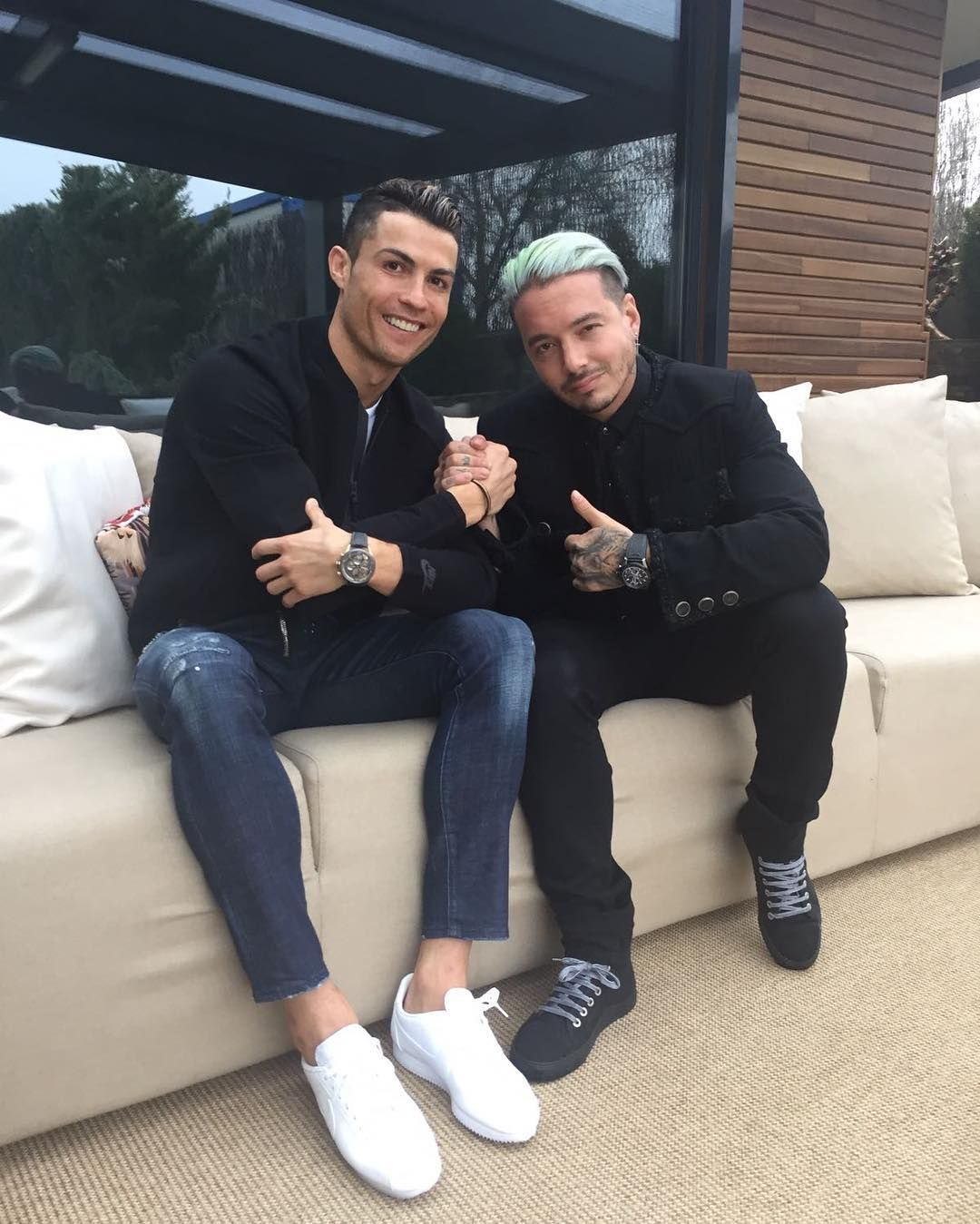 cc5f85e4cd0b Cristiano Ronaldo Wears Nike Jacket, Sneakers, and Dsquared2 Jeans with J  Balvin in Chanel Jacket   UpscaleHype