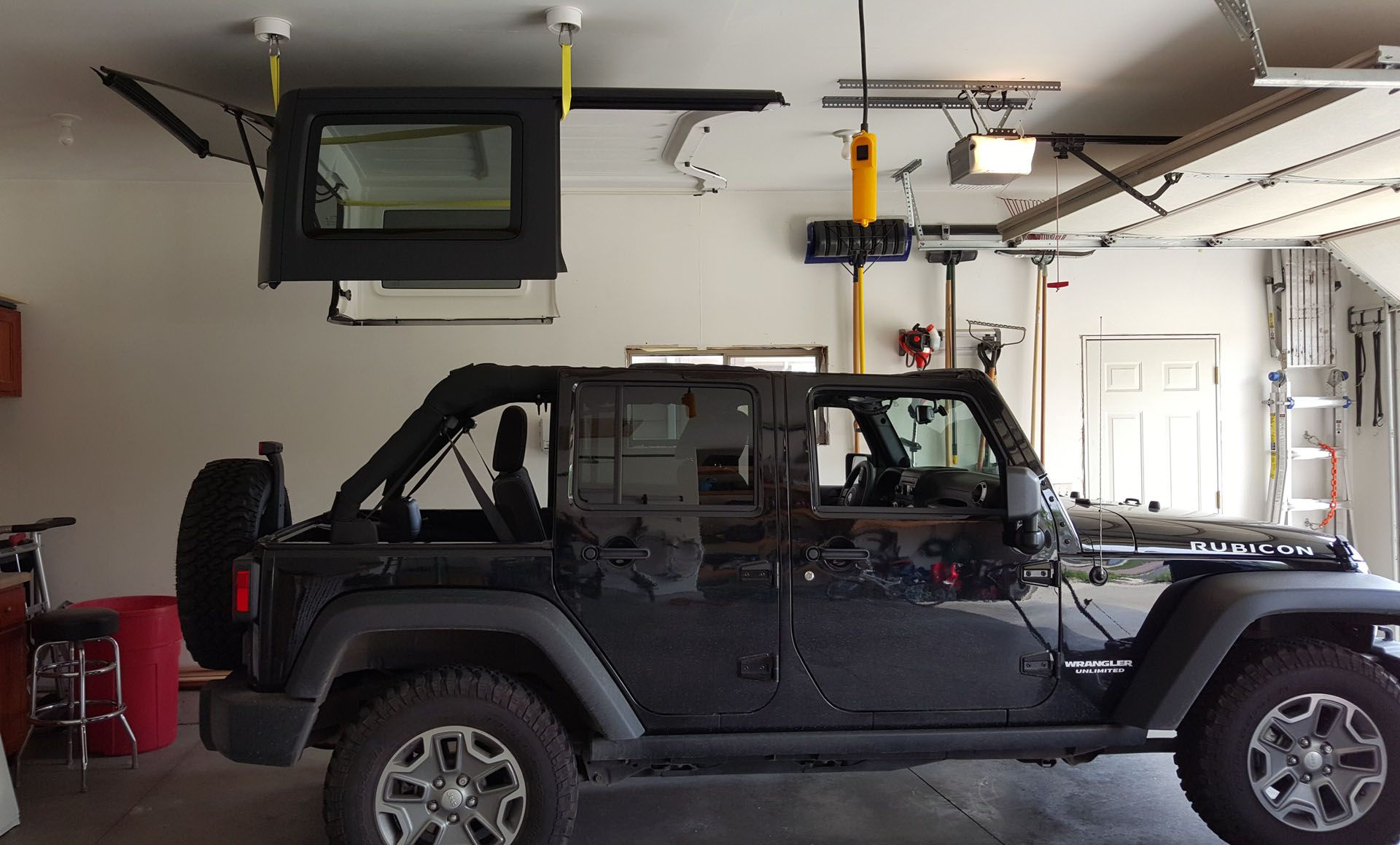 Electric Hoist And Lift Installed In Garage For Jeep Hardtop