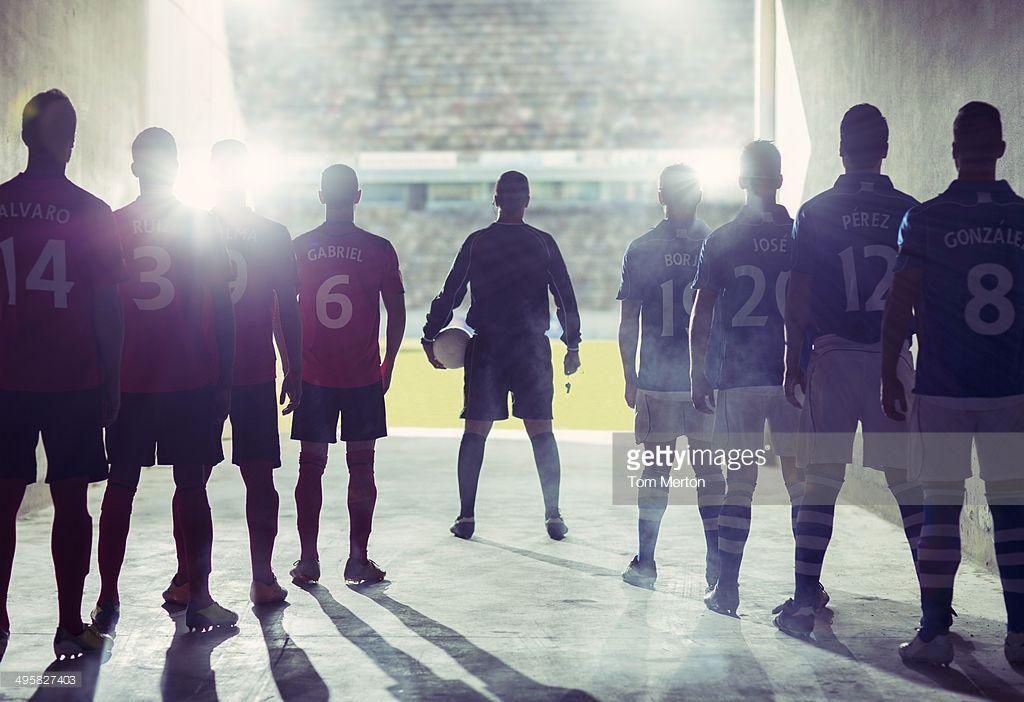 Silhouette Of Soccer Teams Facing Field Imagen De Alta