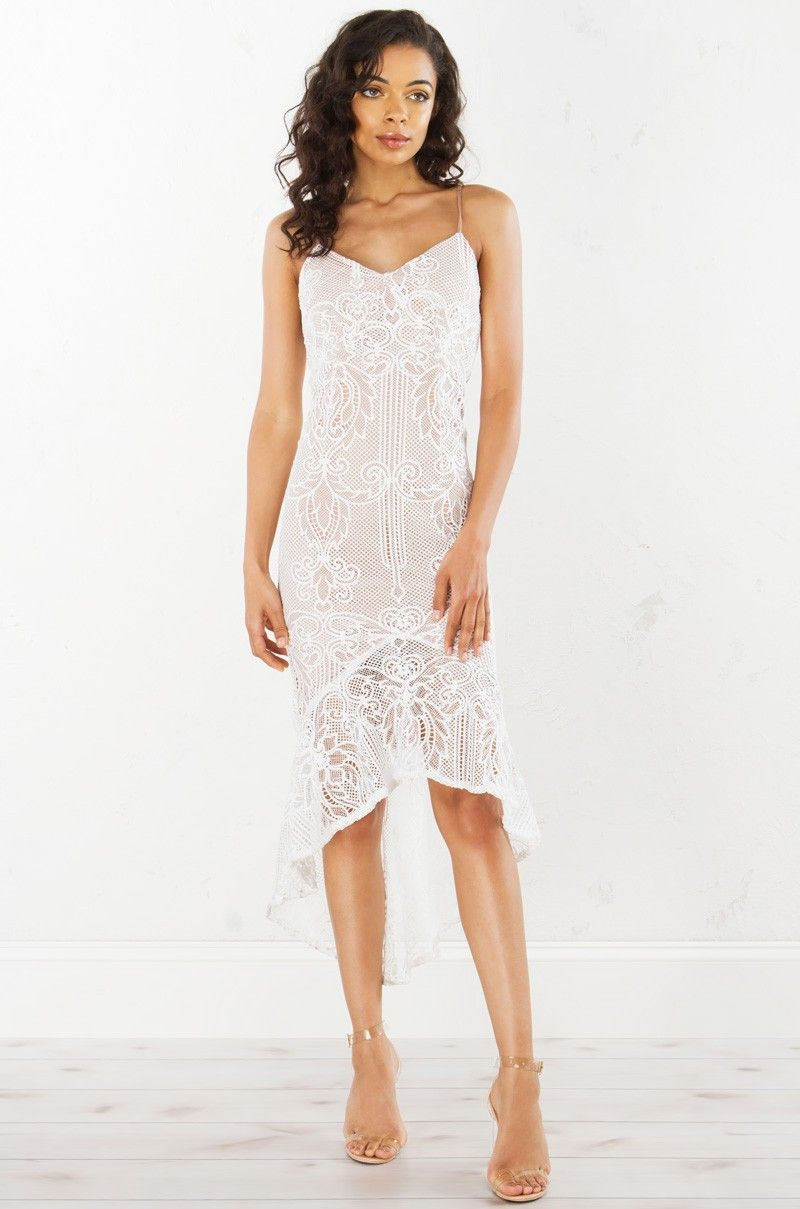 Front view to the races in laces dress in white short wedding