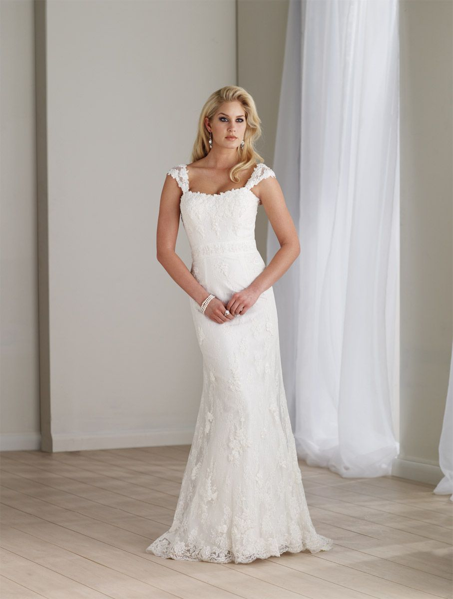 Wedding dress without train  This pretty Wedding Gown has a modified Sweetheart neckline simple