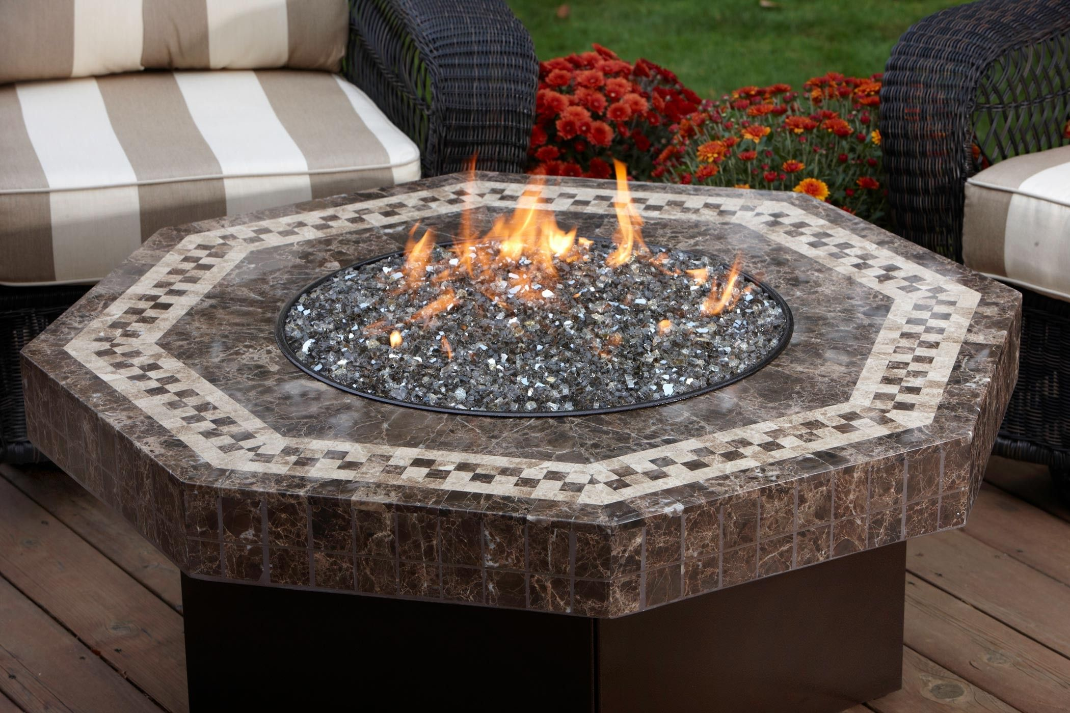 Marble fire table perfect for sipping wine and keeping