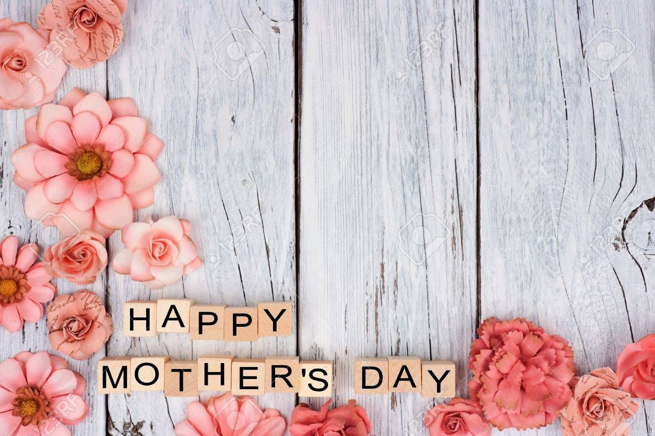 Happy Mothers Day Wooden Blocks With Rustic Paper Flower Bottom Corner Border On A White Wood Backg Mother S Day Background Mothers Day Advertising Mothers Day