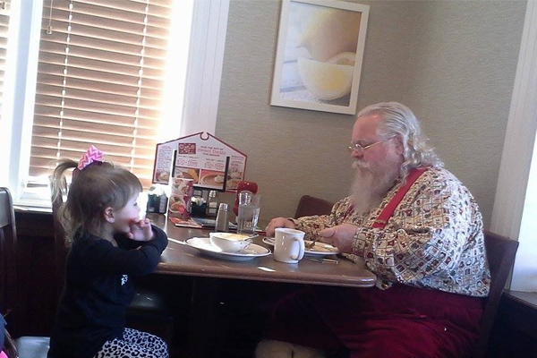 Little Girl Keeps Santa Company So He Doesn't Eat Alone - Kids at Christmas - Redbook