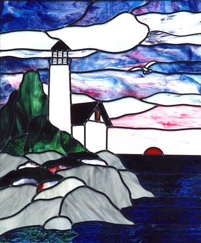 stained glass lighthouse at sunset