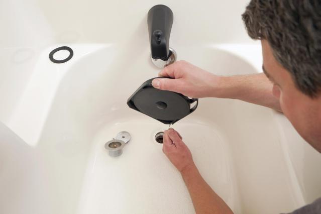 How To Use A Drain Snake To Quickly Clear Shower Clogs Shower Drain Bathtub Drain Bathroom Sink Drain