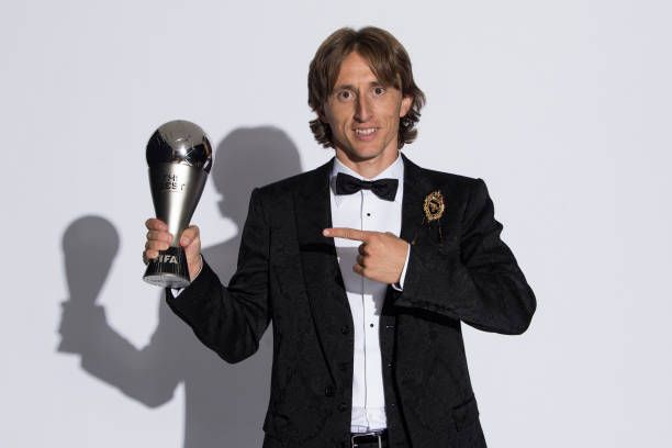 Photo of Luka Modric of Croatia and Real Madrid pose for a photo with his The…