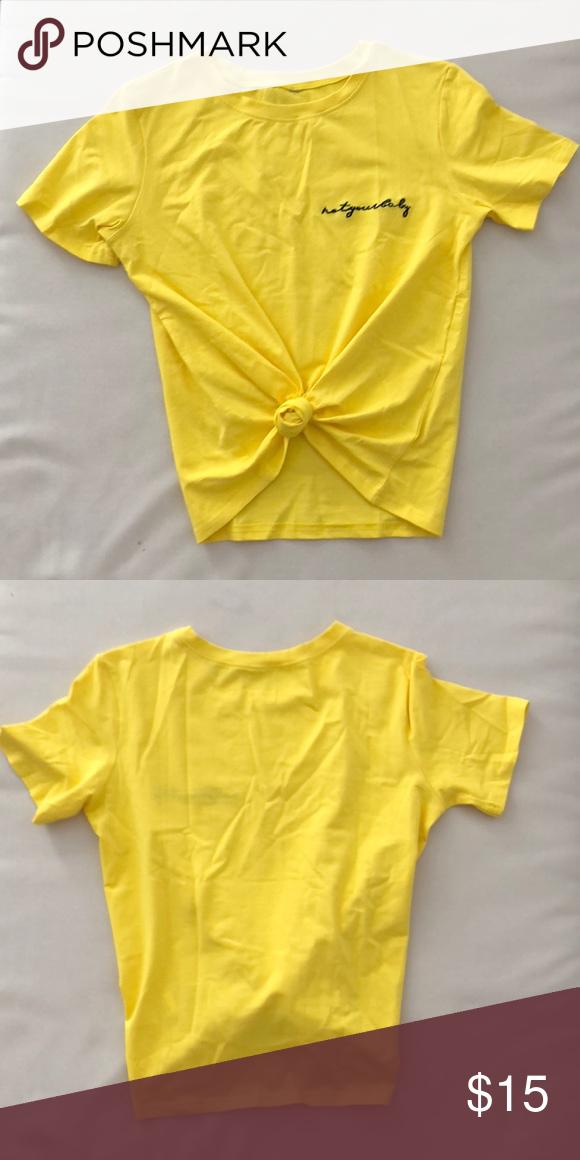 "b09d19de ""Not your baby"" shirt Never worn before, yellow, simple t-shirt! Tops. """