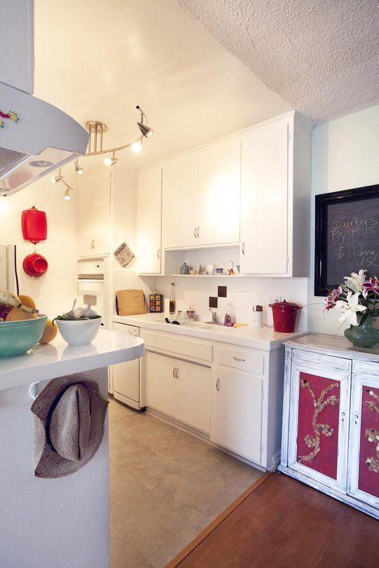 I want that kitchen light fixture!  Cheers up the space.
