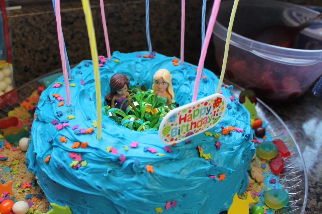Mermaid Bundt Cake With Mermaids In Middle Girls Birthday Party