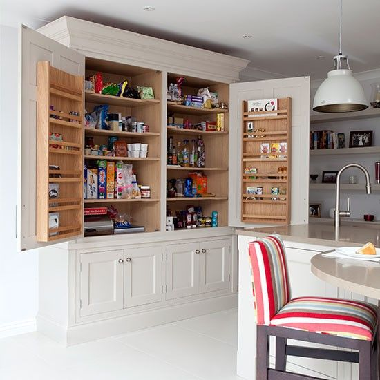 White kitchen with curved wood island kitchen decorating for Oak kitchen larder units