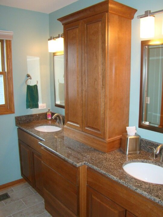 double sink bathroom vanity with dividing storage cabinet