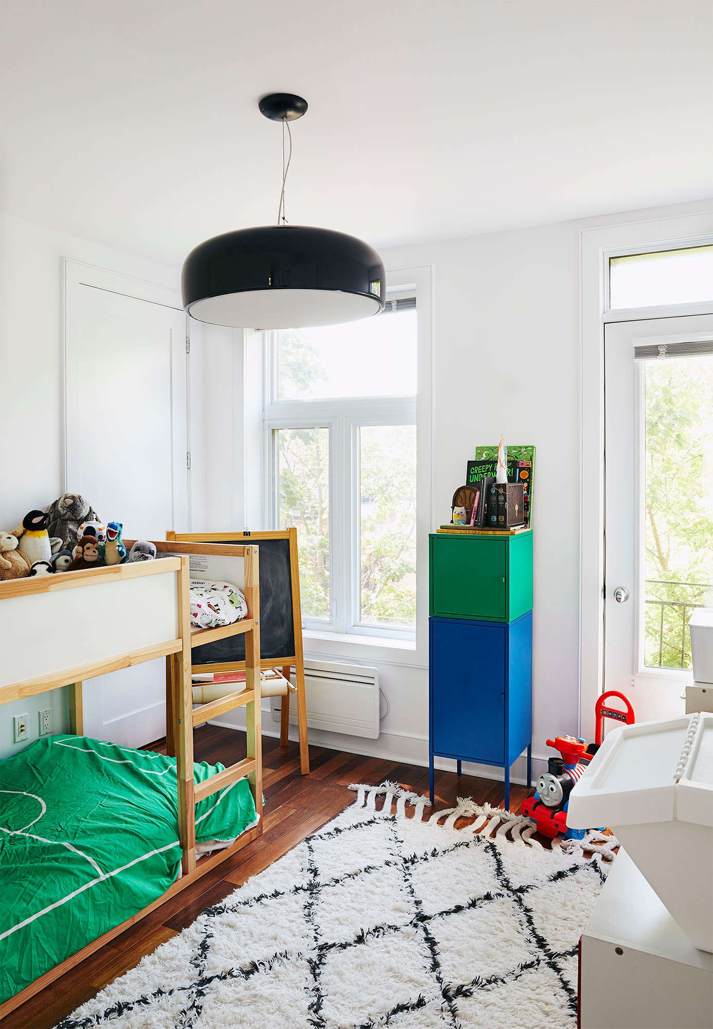 Arthurs bedroom is playful and decorated using different colors bright green blue and red