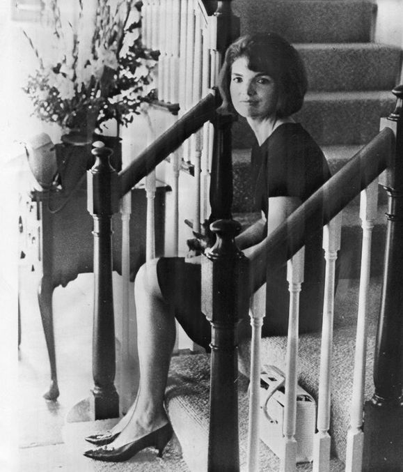 Jackie Sitting On The Stairs Of Her Summer Home.