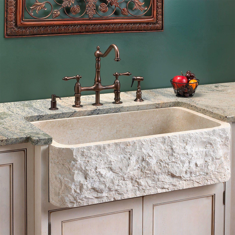 Polished marble single bowl farmhouse sink with chiseled apron