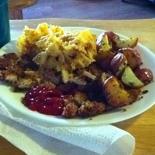 Panko covered fried pork chops, sun-dried tomato basil pasta, and garlic & herb roasted potatoes (: Yum