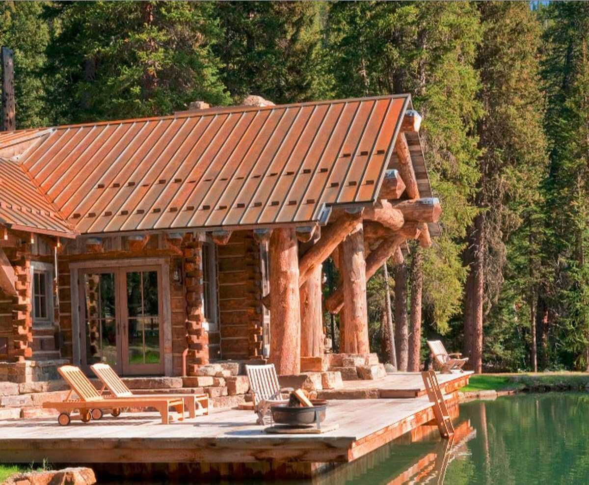 Corrugated metal roof on a log cabin style home metal for Log cabin roof design