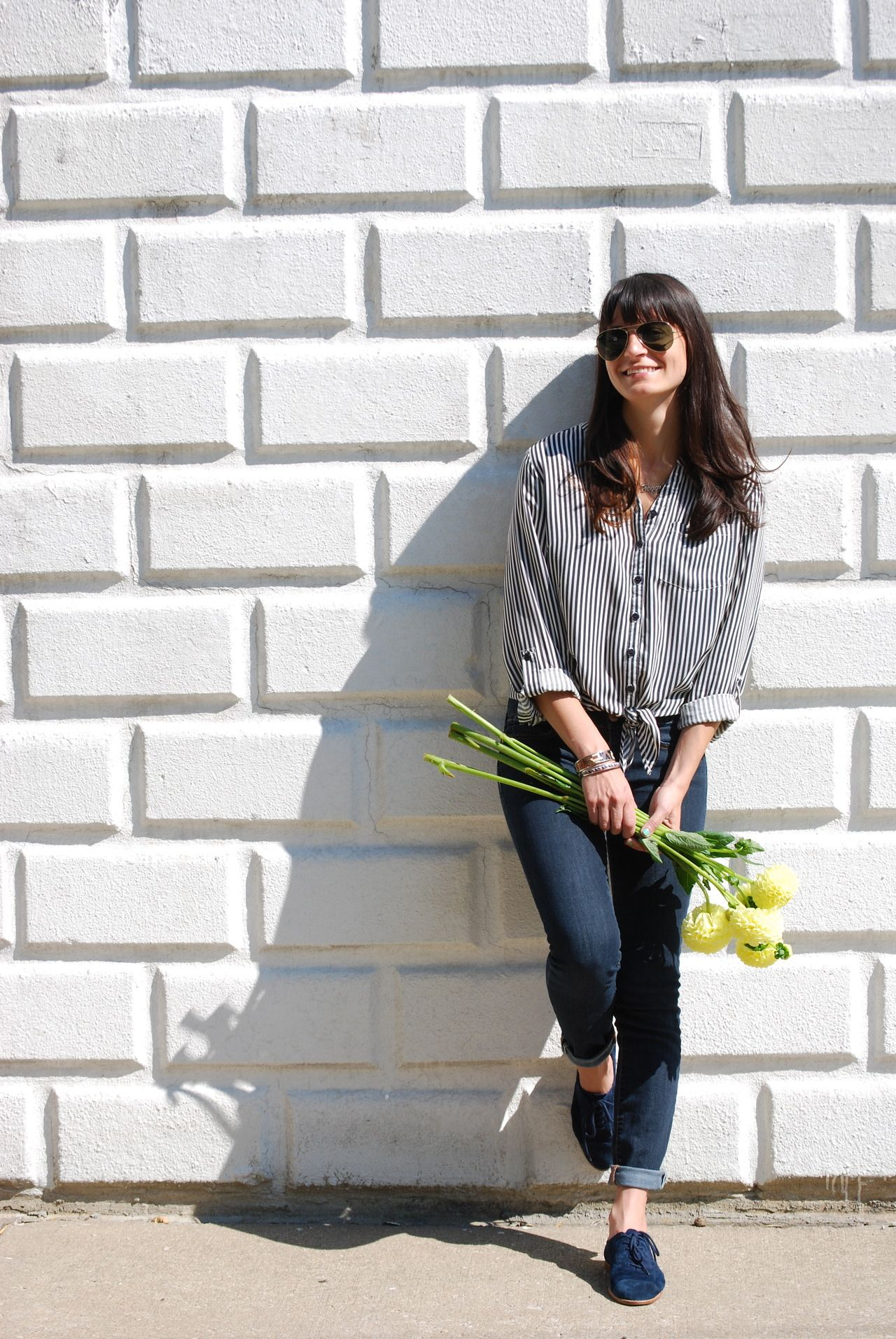 A pair of Gap jeans and shoes as featured on the blog @Peggy.