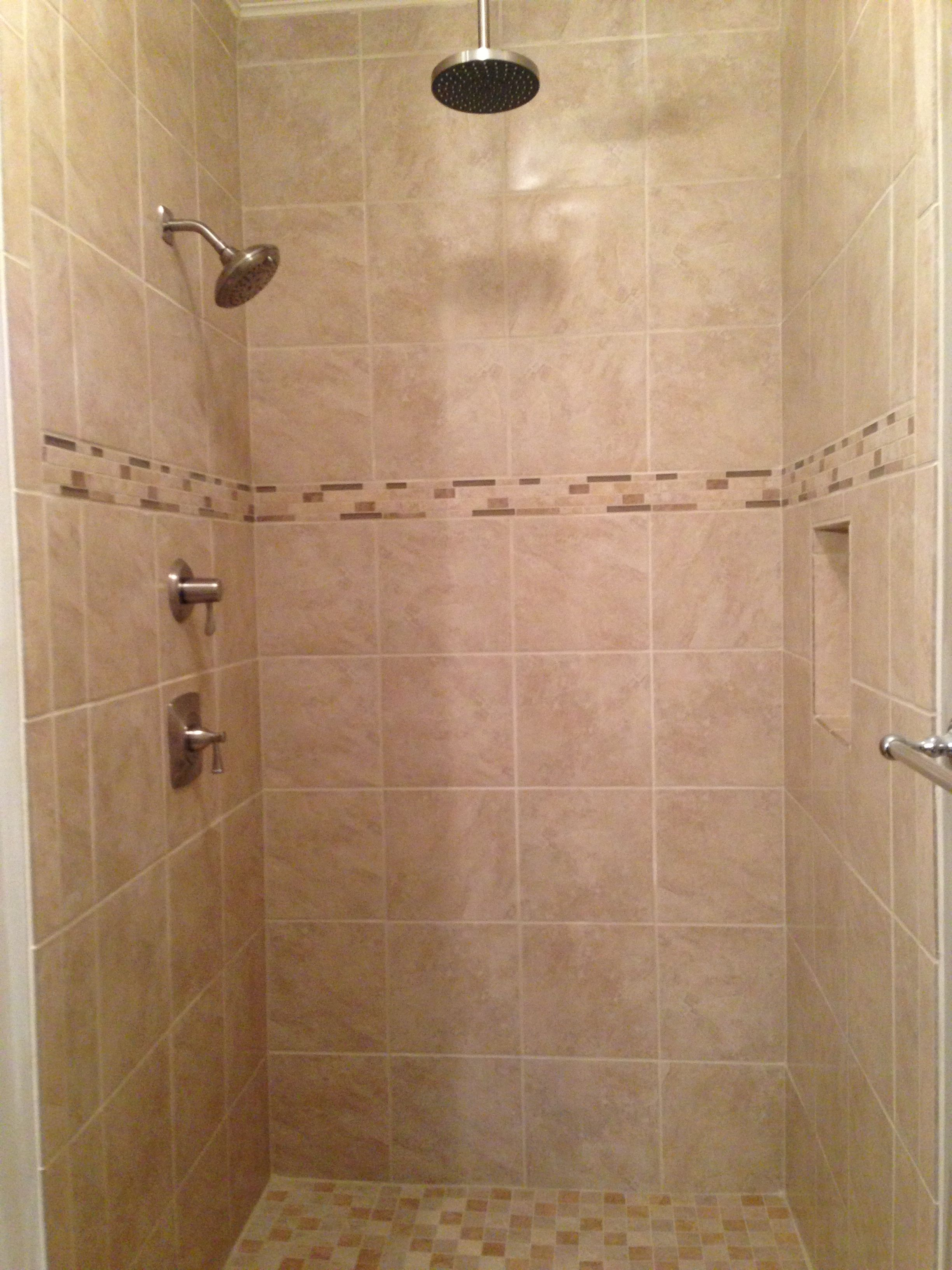 Light beige tile shower with rain head shower fixture. Beige tile ...