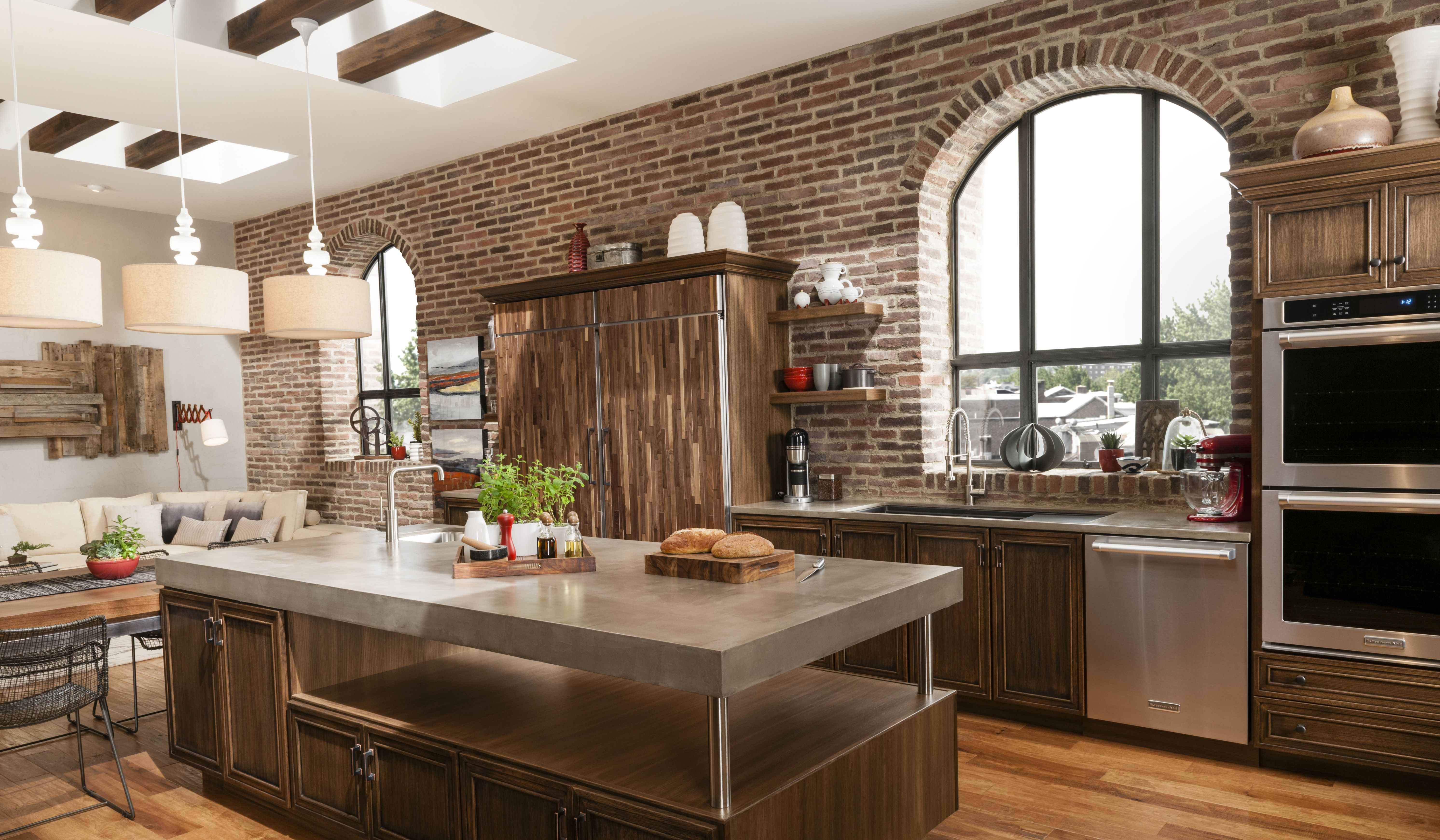 Eldorado Stone RomaBrick accent wall with a modern kitchen island