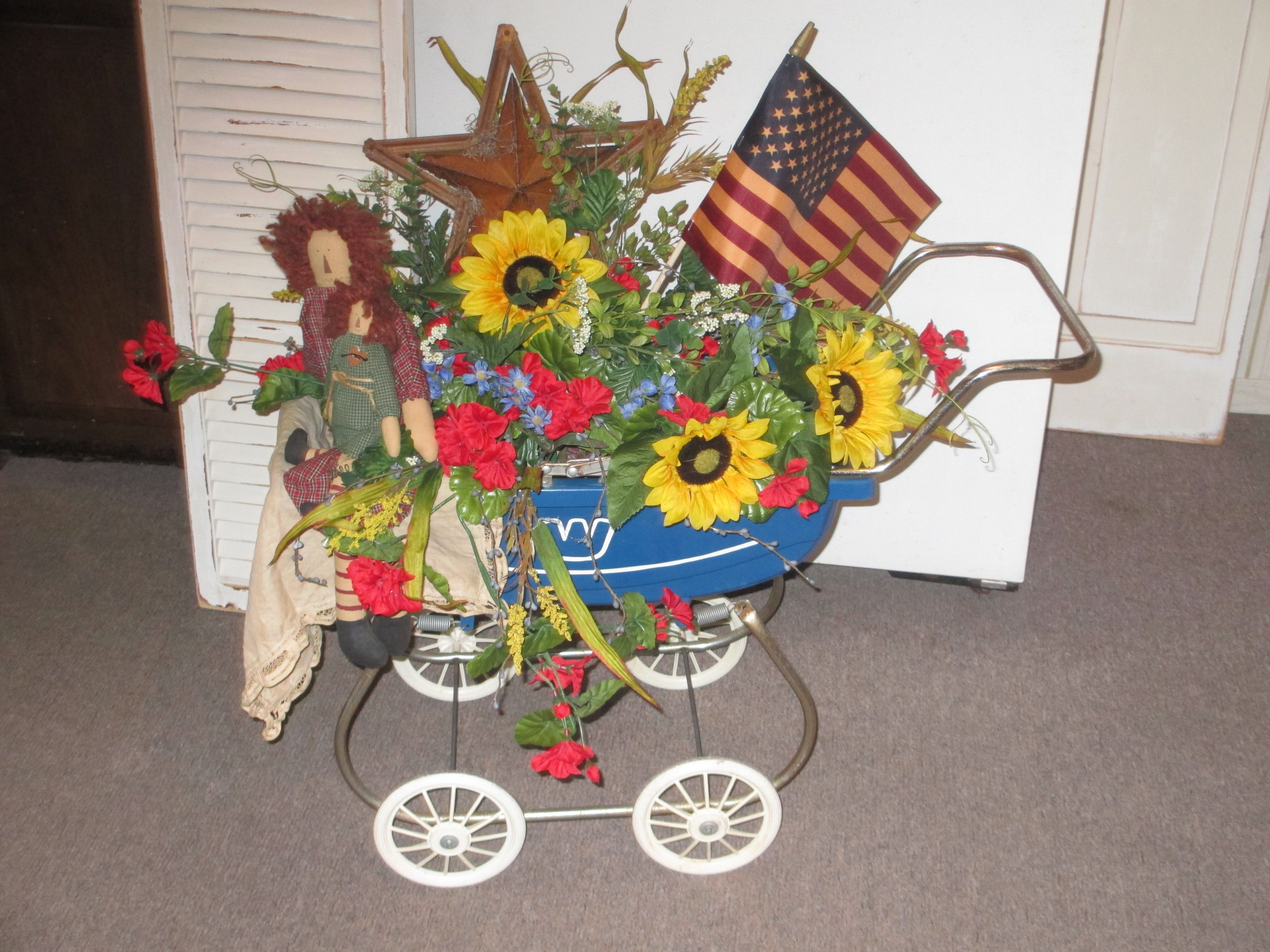 by Joan Larson, doll buggy with added floral, star & flag now a summer display