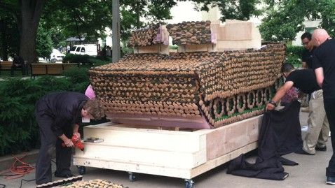 """""""2,500 pound mock-up of an Abrams M1-A1 tank made from 5,000 camouflage colored cupcakes and equipped with a working air cannon capable of firing what else?  A cupcake, of course."""" Made by TLC DC Cupcakes."""