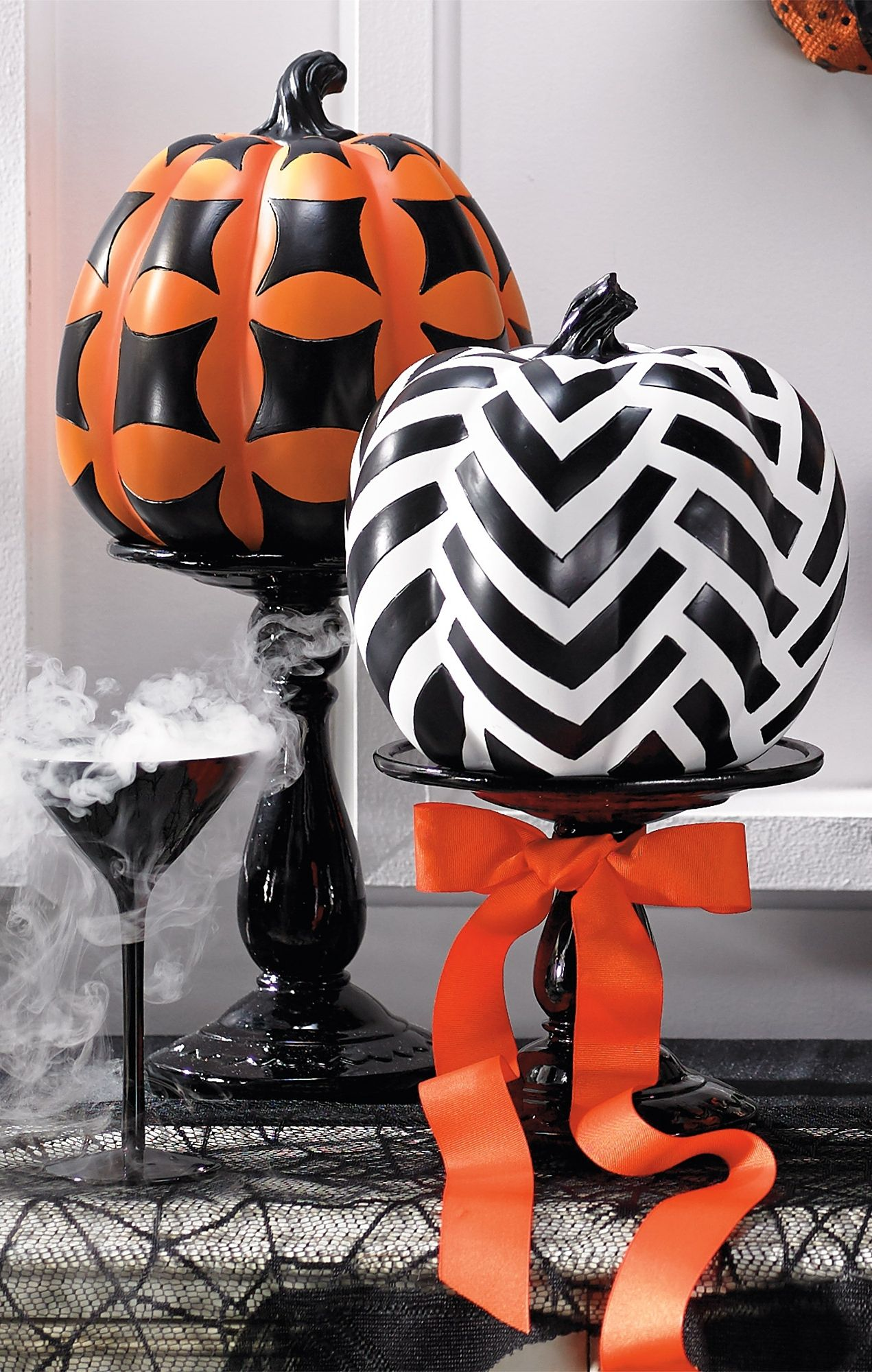 This Halloween, harvest your own everlasting collection of plump designer pumpkins and skip the carving. Each has its own painted personality and is topped with a sculpted black stem; select from a number of sizes, styles and colors.