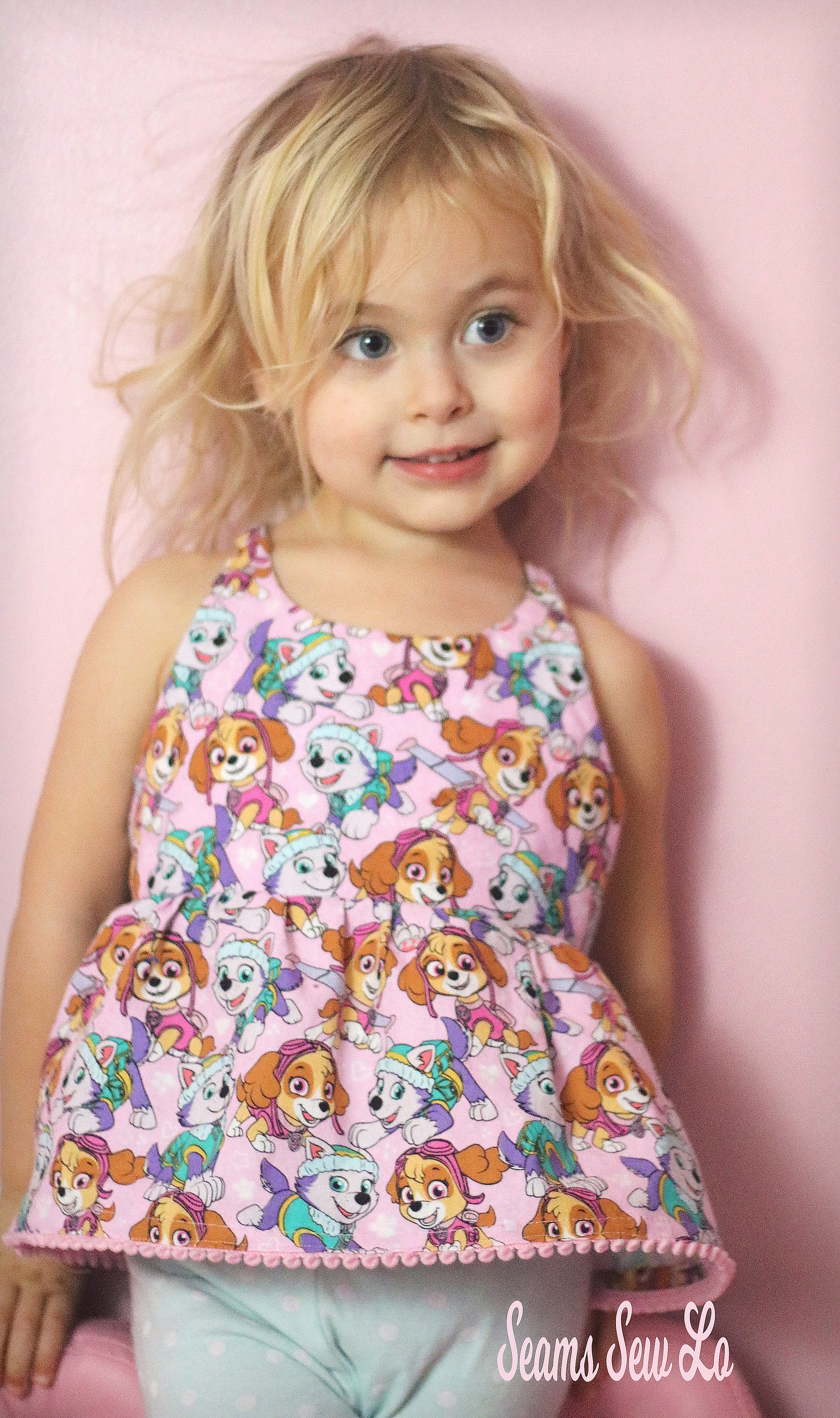 c6952106ad Petite Stitchery Periwinkle girls woven tunic in pink paw patrol Skye and  Everest fabric pink pom pom trim