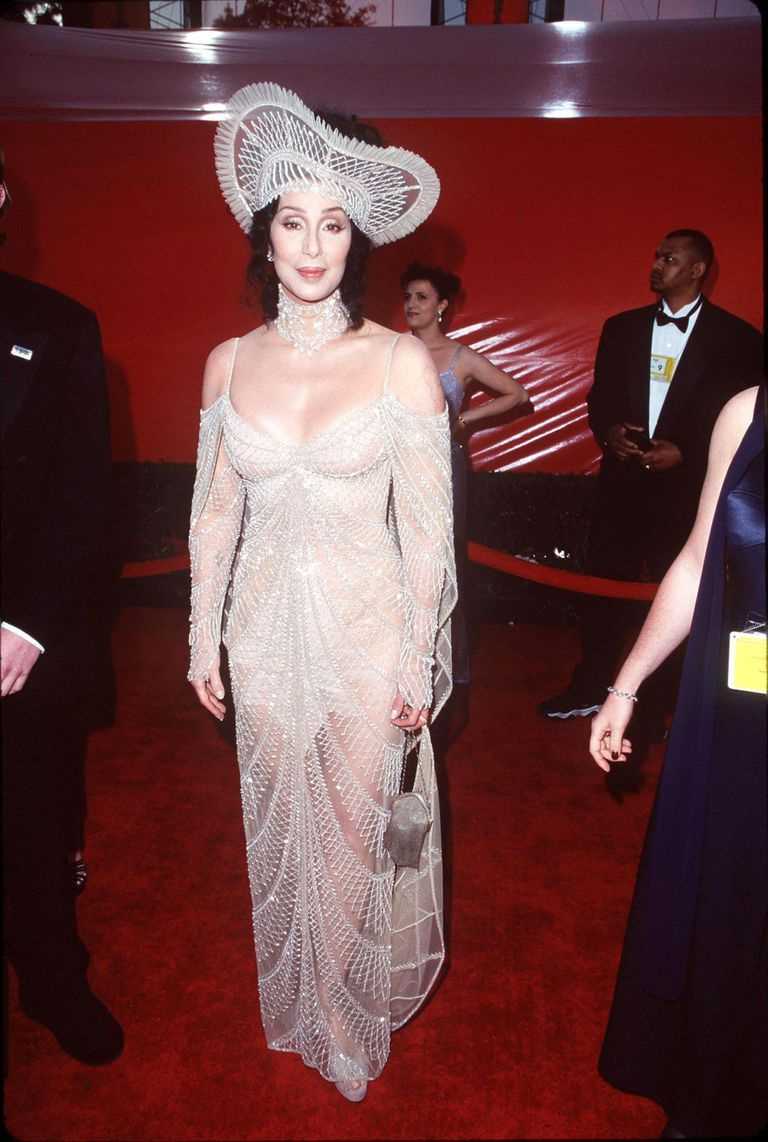 Cher S Most Iconic Fashion Moments Over The Last 6 Decades Oscar Fashion Fashion Cher Outfits