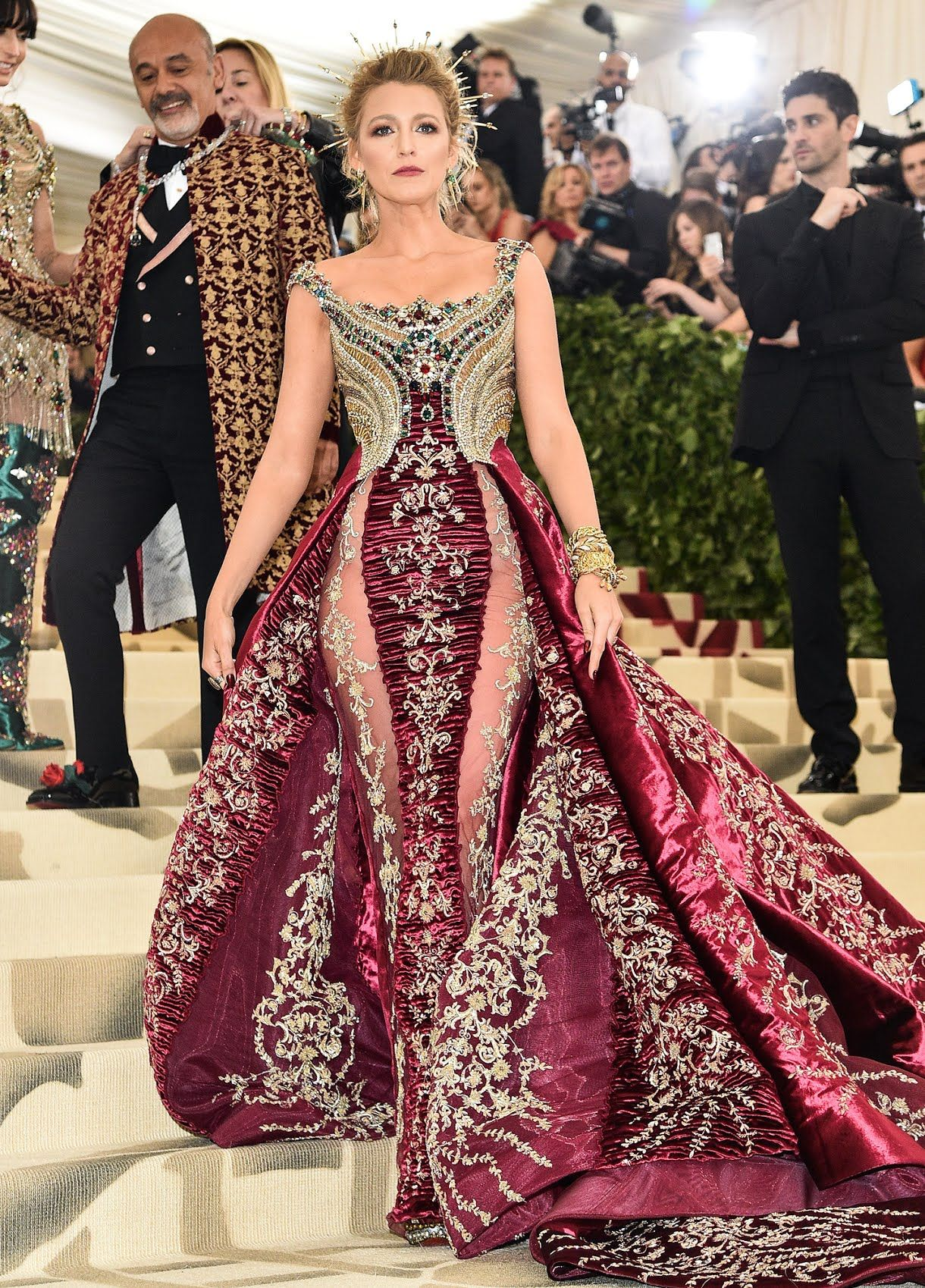 2576a15ed91 2018 Met Gala  Blake Lively is wearing a gorgeous red brocade Atelier  Versace gown with a train and gold headpiece. Blake stuns on the red carpet  as always!