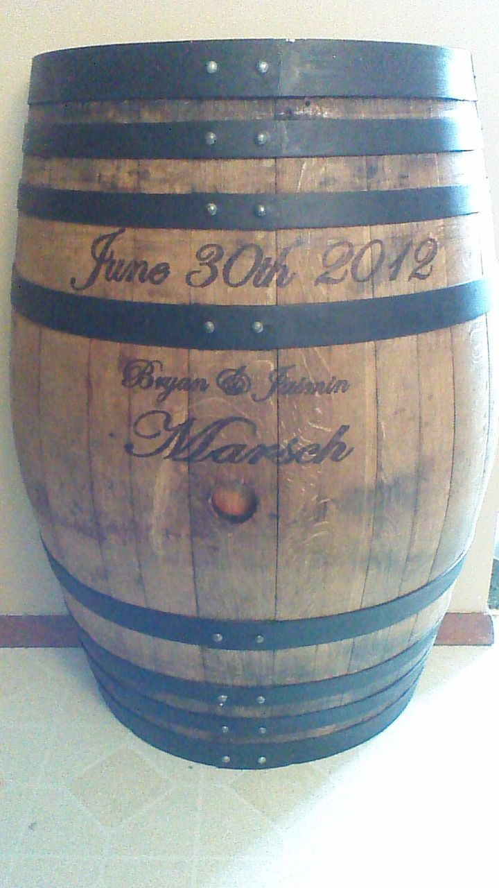 My Husband Took This Wine Barrel And Stained Painted It And Wood Burned Our Wedding Date And Names I Absolutely Love It Wine Barrel Barrel Wedding Rain Barrel