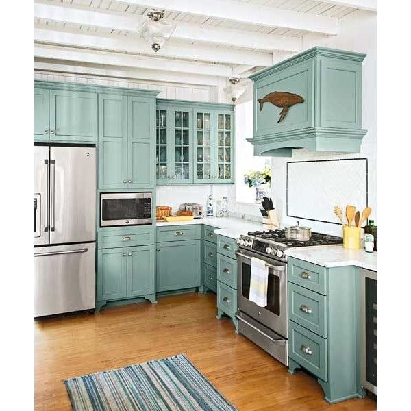 Light Blue Green Farmhouse Kitchen A Great Way To Add Interest And Color Beach Cottage Kitchens Teal Kitchen Cabinets Cottage Kitchens