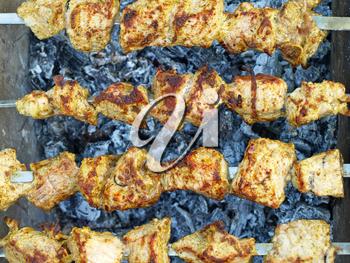 Appetizing  juice shashlik is preparing on barbecue.