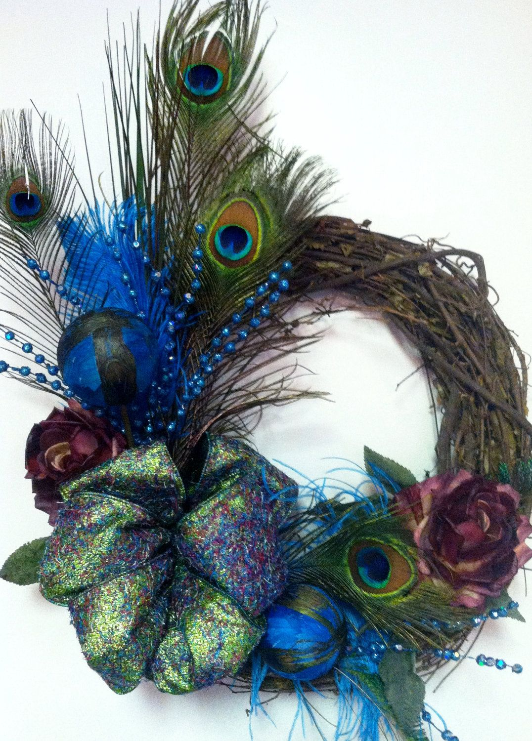 Peacock feather turquoise and rose wreath christi for Peacock feather decorations home