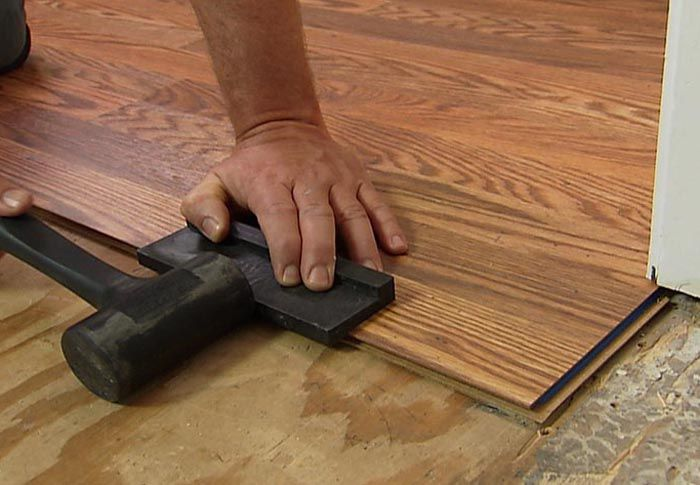 Using A Tapping Block Installing Laminate Wood Flooring Wood