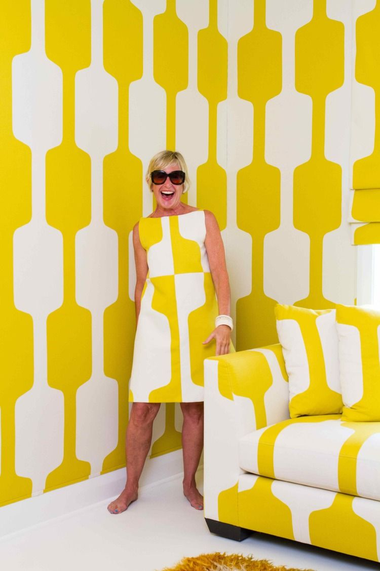 Designer and fabricator Katie Koch in her Pierre Frey fabric upholstered room in New Orleans, Louisiana