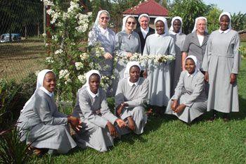 Visit to the mission of the Daughters of Divine Love in Africa, in November 2012.    Photo 1: Zoeli Sr., Sr. Jacinta (visitors), Sr. Alaide, Sr. Marlene and seven novices