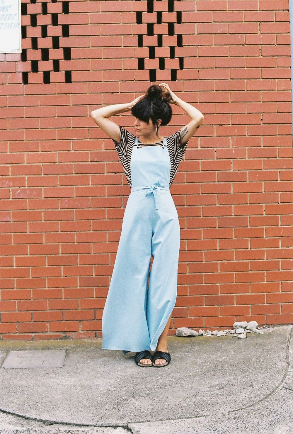 02e02b879687 CAVES COLLECT long wrap overalls in powder blue linen.