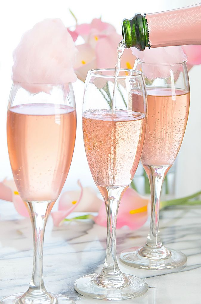 640e0bd593b9 Rosé champagne is topped with fresh cotton candy for a beautiful cocktail  perfect for a garden party
