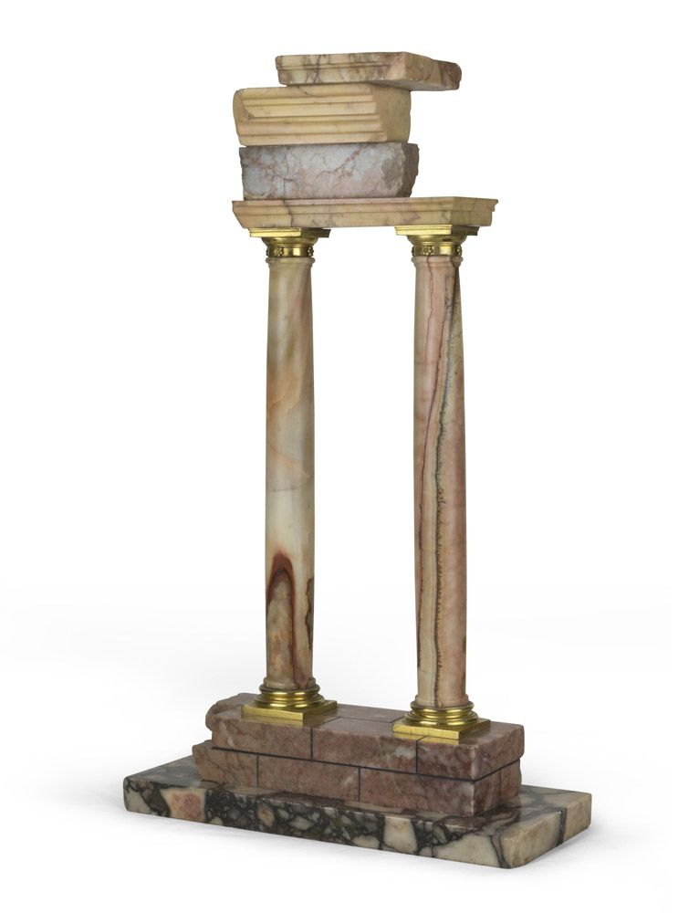 MARBLE MODEL OF CLASSICAL ARCHITECTURE, 19TH CENTURY; representing two Roman columns and lintel. Made of giallo antico, portasanta marble and alabaster with gilt bronze details - Dim: 50 x 28 x 12. cm
