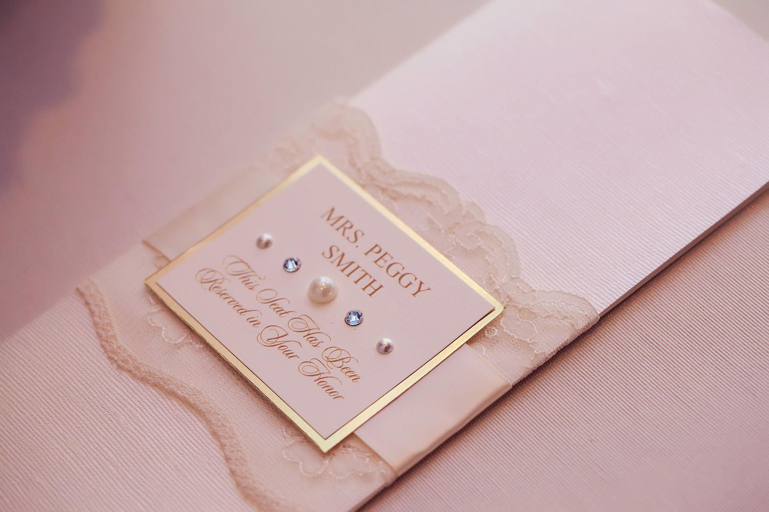 Lace wrapped menus with custom place card http://www.theeventessentials.com/