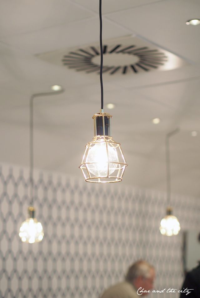 Fazer Café, Helsinki: Work Lamp Gold designed by Form Us With Love for Design House Stockholm.