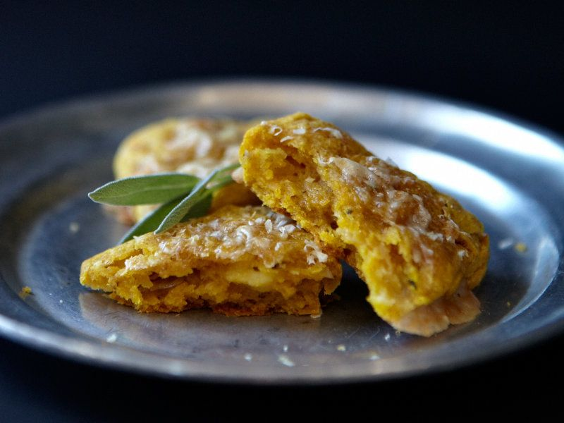 Savory Pumpkin Scones with Gruyère and Sage | Rich but light, this savory scone recipe partners equally well with bacon and eggs or a hearty soup. The Gruyère becomes gooey inside the scones during baking.