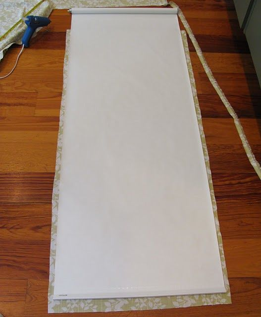 Covering cheap roller blinds with pretty fabric -- genius.