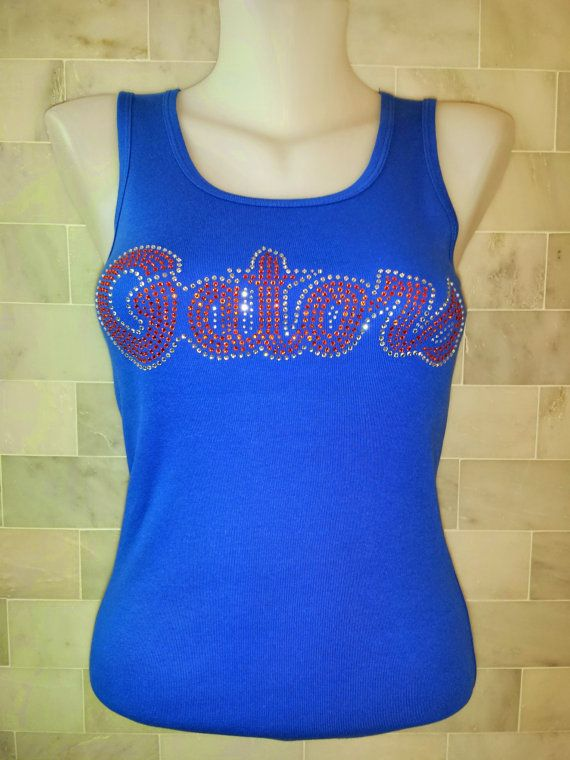 Show your team spirit with this awesome University of Florida Script Logo Bling-A-Tee Bling shirt. You will be the envy of all your friends when