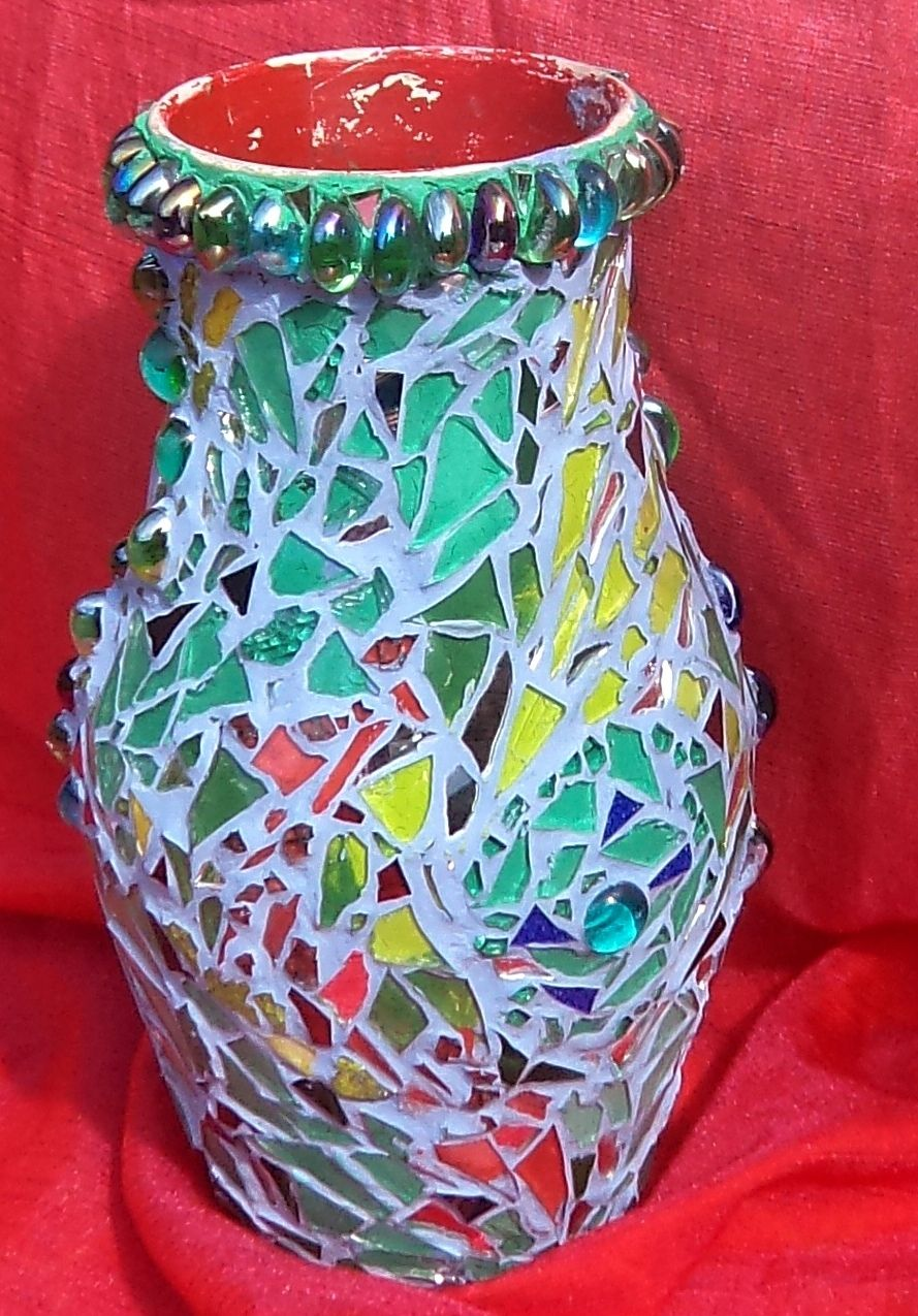 Upcycled vase covered with broken glass mosaic. Made by